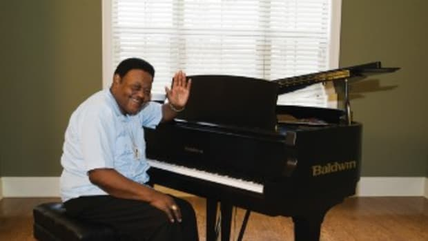 Fats Domino at home, sitting beside his piano. Domino had to be resuced from his New Orleans-area home in the aftermath of Hurricane Katrina.