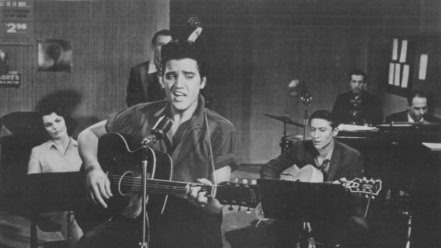 """ELVIS PRESLEY performs in a recording session for his movie, """"Jailhouse Rock."""" Photo courtesy MGM/1957 Loew's Inc."""