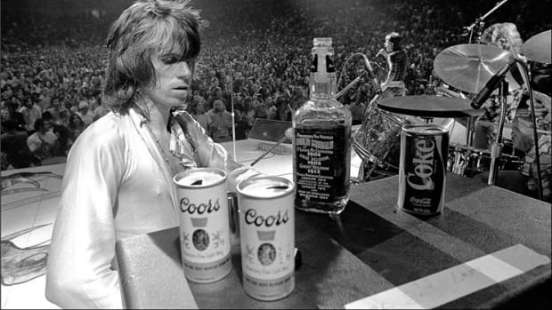 Rolling Stones guitarist Keith Richards assesses the choices at a makeshift onstage bar during the band's 1972 U.S. tour. The moment was captured by Ethan Russell. Photo courtesy Morrison Hotel gallery.