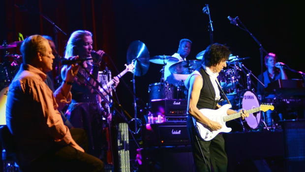 Brian Wilson (seated at left) makes an appearance during guitarist Jeff Beck's set Oct. 6 at the Sands Event Center in Bethlehem, Pa. (Photo by Chris M. Junior)