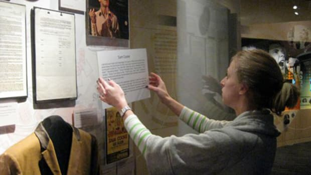 GRAMMY Museum Registrar Ali Stuebner putting the finishing touches on the Sam Cooke display pod.