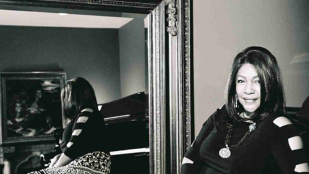 A PAINTING OF THE SUPREMES is visible in the reflection in this photo of Mary Wilson, who was the only constant member of the group. Photo by Ian Wright