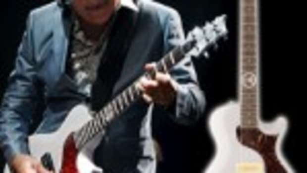 Carlos Santana is shown with a Paul Reed Smith Abraxas SE model guitar.