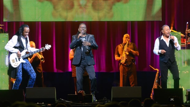Earth, Wind & Fire's current lineup features (foreground from left) founding members Verdine White, Philip Bailey and Ralph Johnson. (Photos by Chris M. Junior)