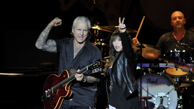 "Neil Giraldo and Pat Benatar performing live in New Jersey, May 2015, to support their ""35th Anniversary Tour"" CD/DVD — a tribute to a strong collaboration together. ""It's remarkable in the number,"" says Giraldo. ""It's not remarkable in the fact of it happening."" Photo by Frank White."
