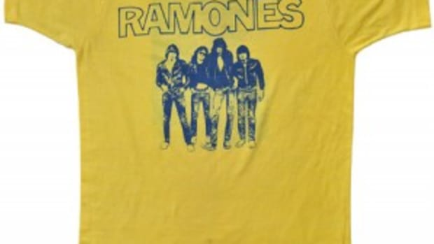 "Ramones"" t-shirt, owned and worn by Dee Dee Ramone in 1976. Accompanied by a photograph of Dee Dee Ramone wearing an identical t-shirt. Dee Dee is also seen wearing an identical t-shirt in the documentary ""Johnny Ramone: Too Tough To Die"", 1996."