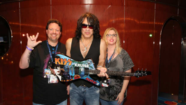 Fans get exclusive acces to their favorite groups on band cruise ships. Here is Paul Stanley with KISS KRUISE V guitar and fans Ryan Barks and Angela Simmons.