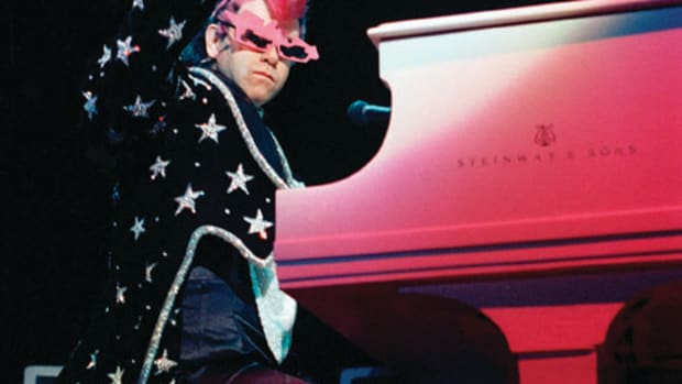 Elton strikes a glamorous pose at his piano. AP photo