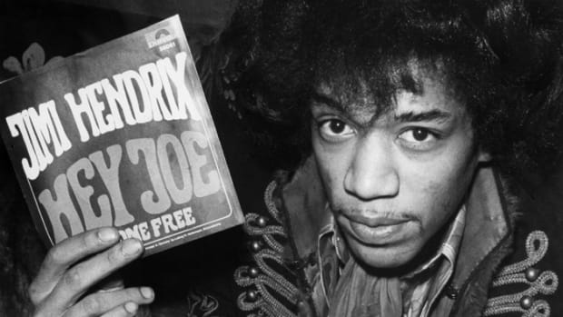 "HEY, IT'S MY RECORD! Jimi Hendrix holding up his latest 45, ""Hey Joe,"" in Hamburg, Star-Club, March 1967. Photo by Conti-Press/ullstein bild via Getty Images."