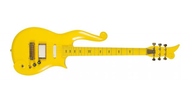 "A Yellow Cloud guitar custom made and stage played by Prince. The guitar has black Love Symbols down the neck and a plaque on the back that reads ""Property of PRN Music Corp."" Serial number 16212. Accompanied by a signed letter of authenticity on Paisley Park Enterprises letterhead from Jenifer Carr, director of finance and operations, stating that the guitar has been used in rehearsals and performances all over the world. The guitar is housed in a hardshell case."