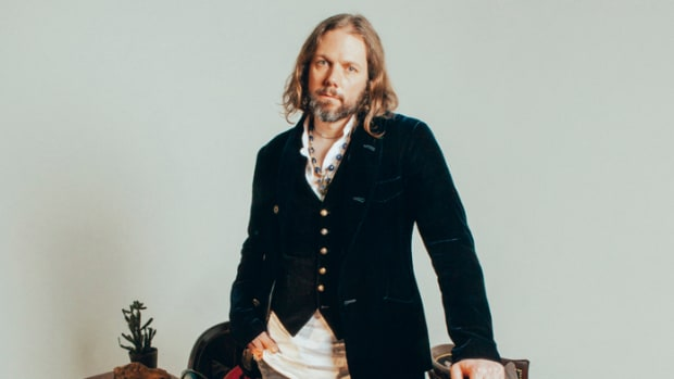 Rich Robinson poses with some of his favorite guitars. Photo by Alysse Gafkjen.