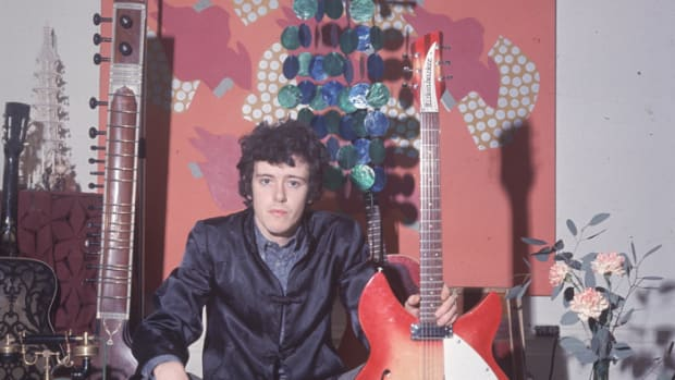 Donovan (Donovan Leitch) during the 1960s holding his Rickenbacker guitar and a flute, a sitar and other guitars in the background. (Photo by Keystone/Getty Images)