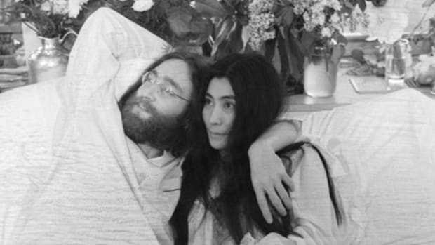 John Lennon and Yoko Ono, his bride of three months at the time this photo was taken in Montreal in June 1969, pose in bed. They held, in bed, press conferences in several cities with the theme, 'make love, not war.' Photo from the Bettmann Collection via Getty Images.