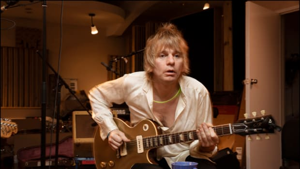 Zak Starkey in the studio with his guitar. Photo by Jill Furmanovsky.