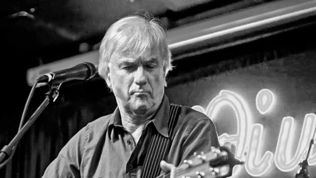 Jim McCarty of The Yardbirds playing acoustic guitar at the Iridium Jazz Club in 2012. Photo by Arnie Goodman.
