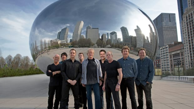 The current lineup of Chicago (L to R): Tris Imboden, Wally Reyes, Jr., Jason Scheff, Keith Howland, Lee Loughnane, Walt Parazaider, Jimmy Pankow, Robert Lamm and Lou Pardini. Publicity photo.