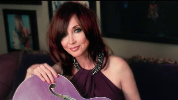 Pam Tillis purple guitar