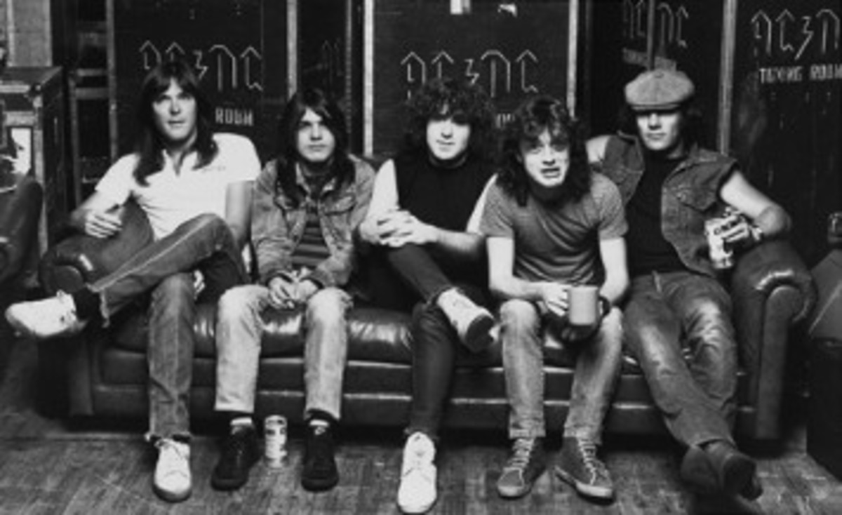 After Bon Scott died in 1980, AC/DC replaced him with Brian Johnson (far right).
