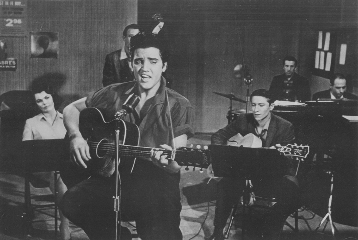 "ELVIS PRESLEY performs in a recording session for his movie, ""Jailhouse Rock."" Photo courtesy MGM/1957 Loew's Inc."