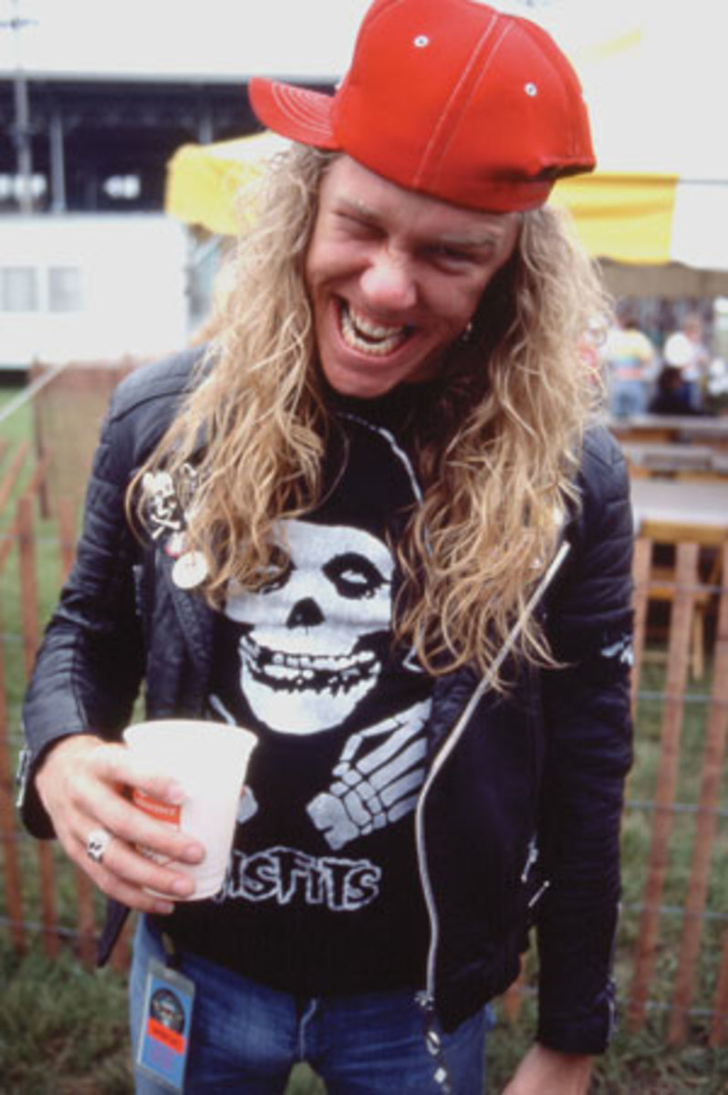 JAMES HETFIELD enjoys a brew at the May 1986 Iowa Jam in Des Moines. (Frank White/Frank White Agency).