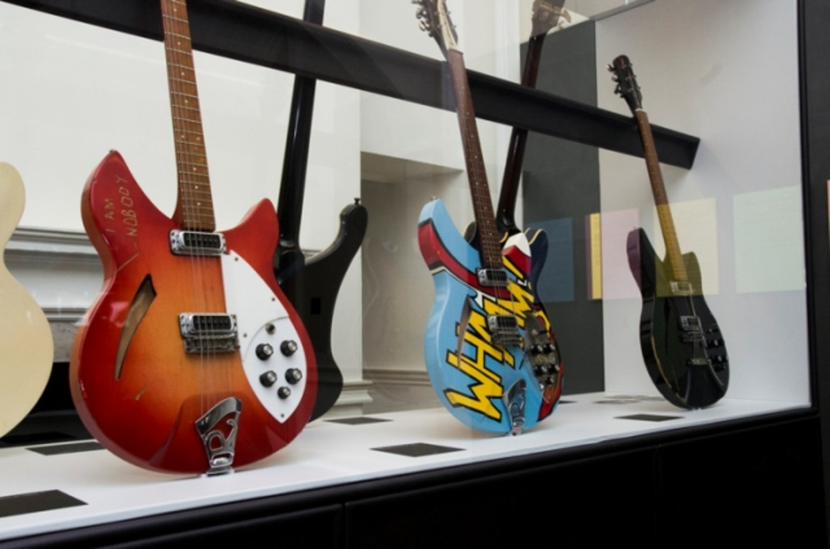 Some of the guitars displayed in the exhibition are shown here, with the one in the center giving evidence of the band's interest in pop art. (Photo by Dean Fardell for Nicetime Productions)