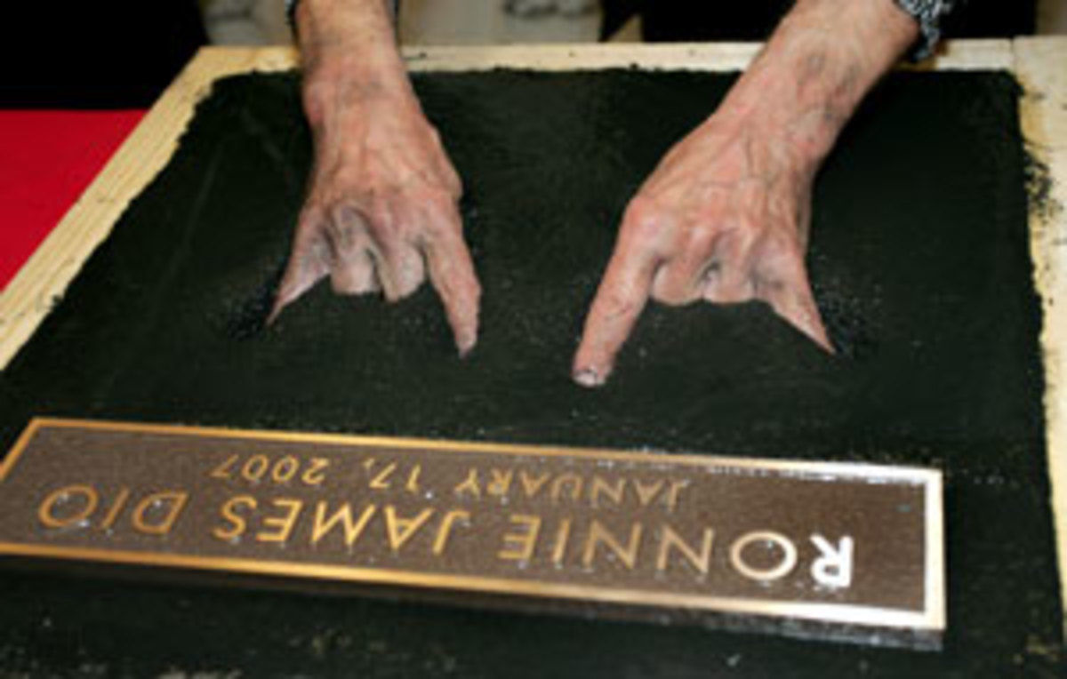 The Maloik cemented: The gesture that Dio popularized becomes part of the Hollywood RockWalk in Los Angeles in 2006. (AP Photo/Branimir Kvartuc).
