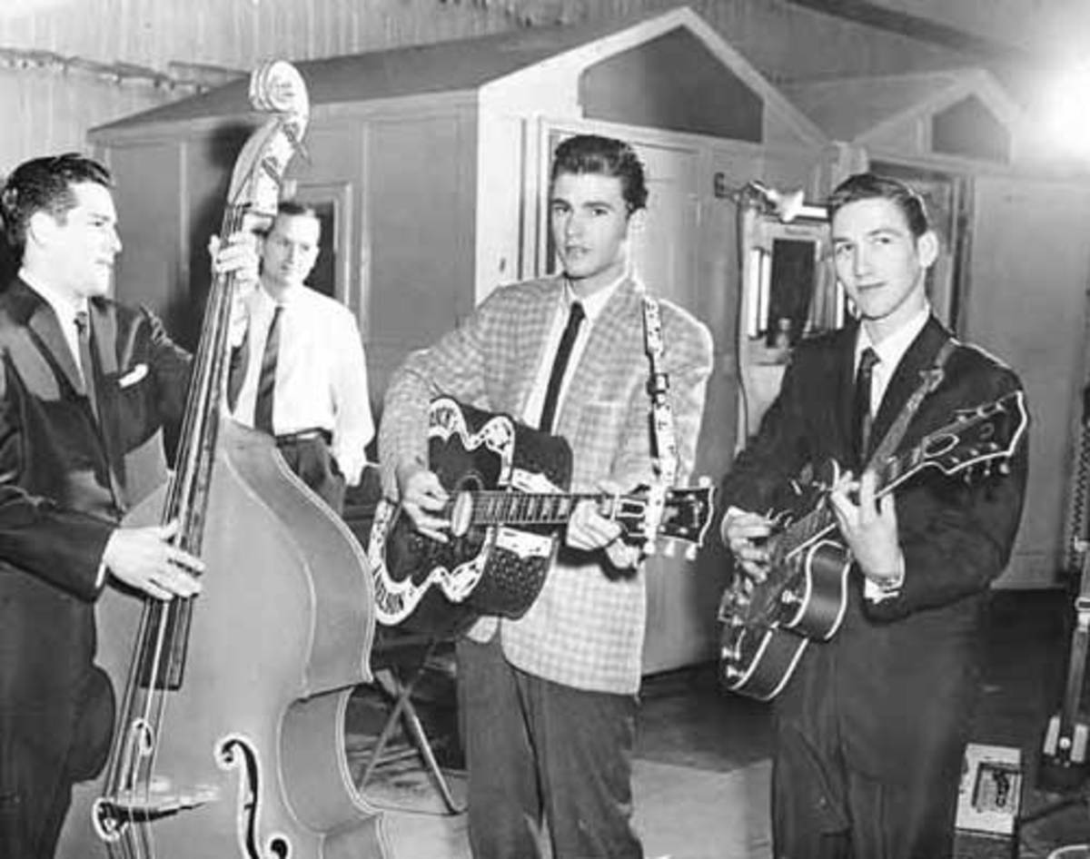 """GUITARIST JAMES BURTON (right) and bassist James Kirkland (left) collaborated with Ricky Nelson (center) as part of Nelson's backing group on """"The Adventures of Ozzie and Harriet."""" Photo courtesy Bear Family records"""