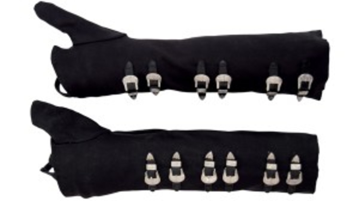 "Pair of black spandex gloves covered with silver buckles that Jackson wore for the ""Bad"" album cover photo shoot"