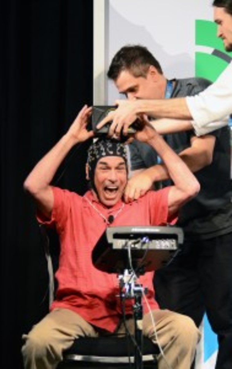 "Mickey Hart rejoices after finishing a demonstration of NeuroDrummer during the ""Rhythm and the Brain"" panel. (Photo by Chris M. Junior)"