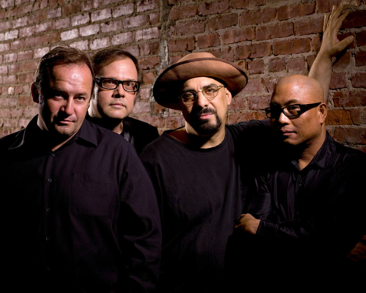 """Today's incarnation of The Smithereens consists of (from left) Jim Babjak, Dennis Diken, Pat DiNizio and Severo Jornacion, aka """"The Thrilla."""""""