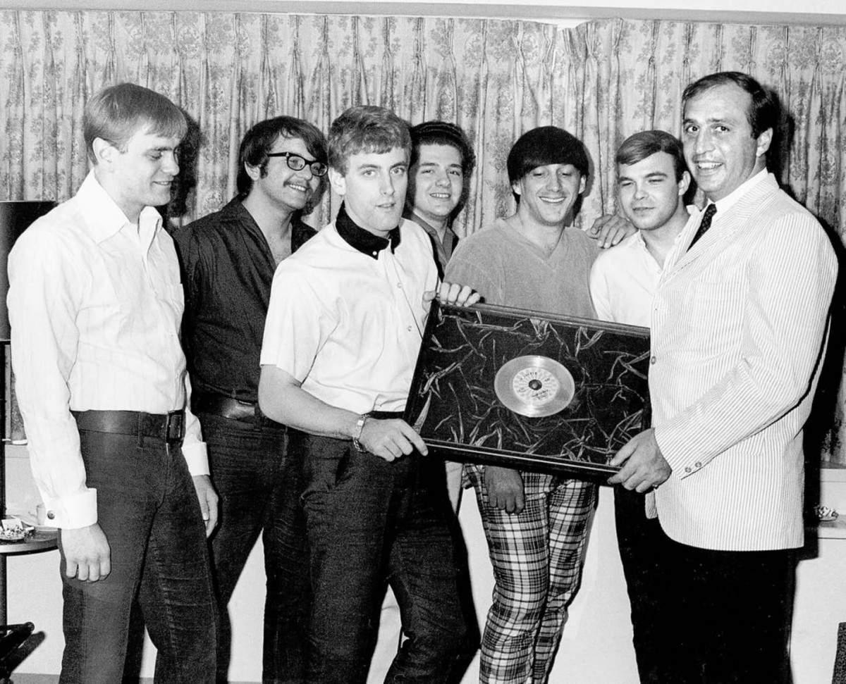 """ROULETTE RECORDS PRESIDENT Morris Levy presents Tommy James and The Shondells with the group's first gold record award in 1966 for """"Hanky Panky."""" Photo courtesy of Tommy James/Scribner"""