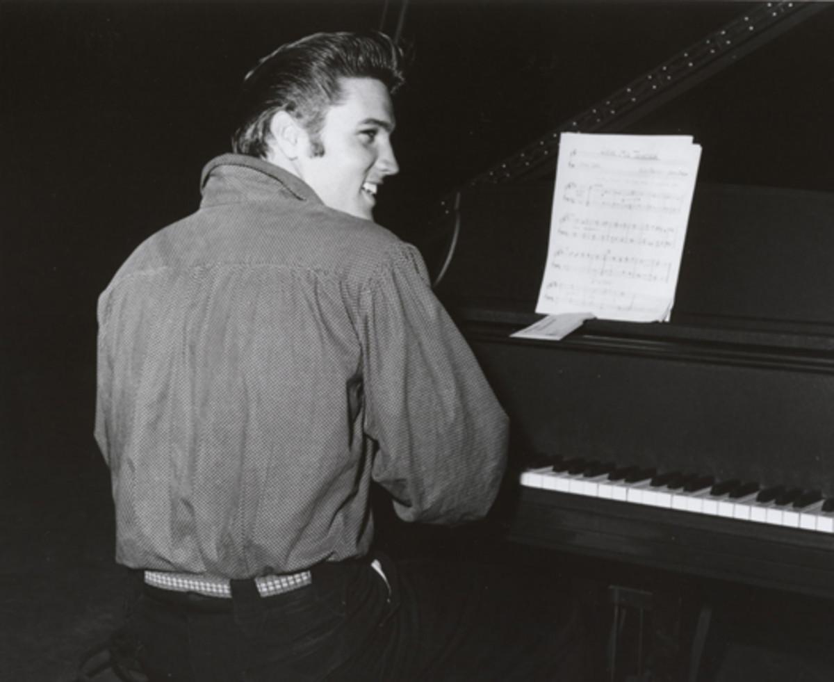 Elvis at piano. Photo courtesy Sony