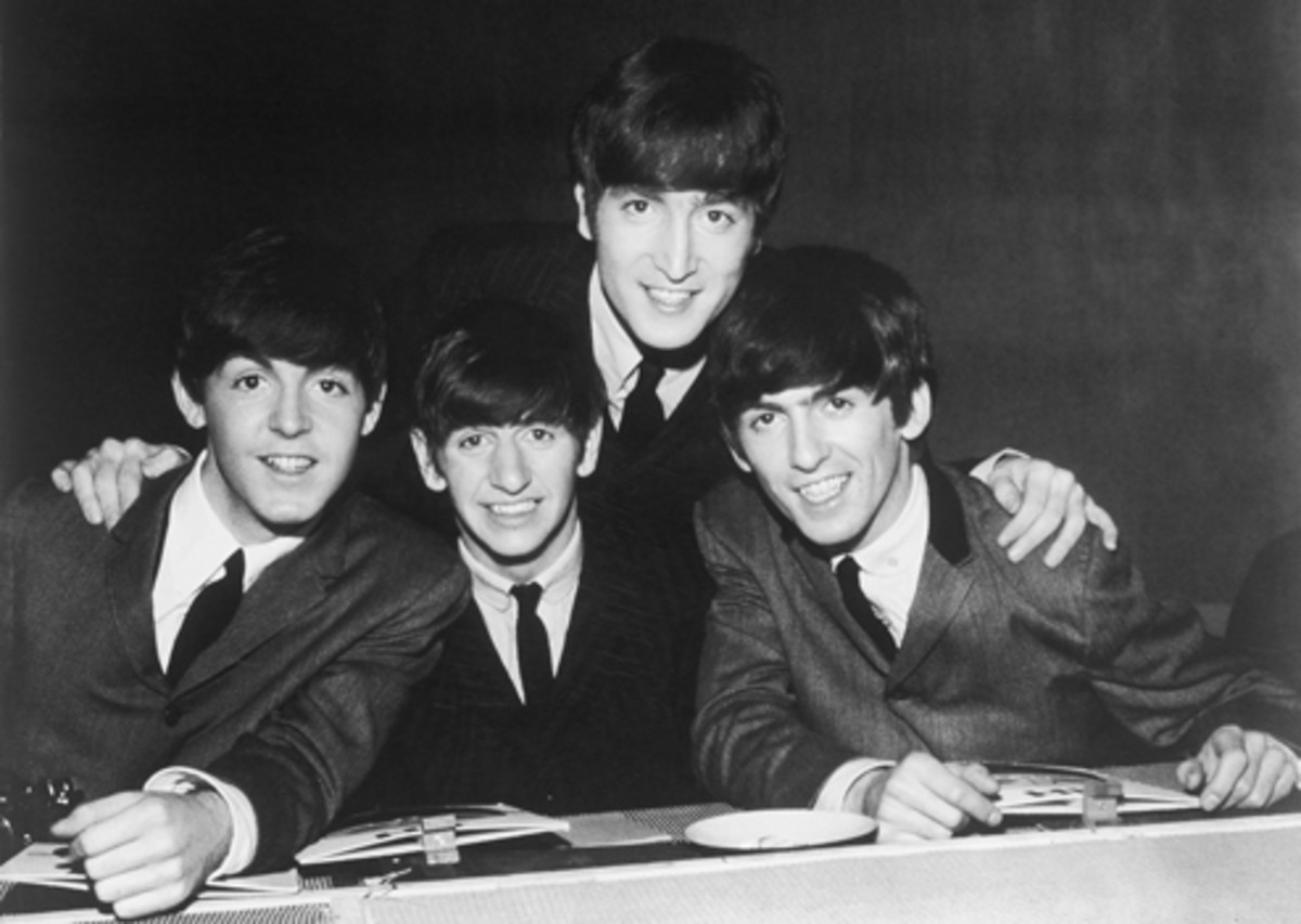 An easy cameraderie is evident among The Beatles in this early press photo. Promotional Photo