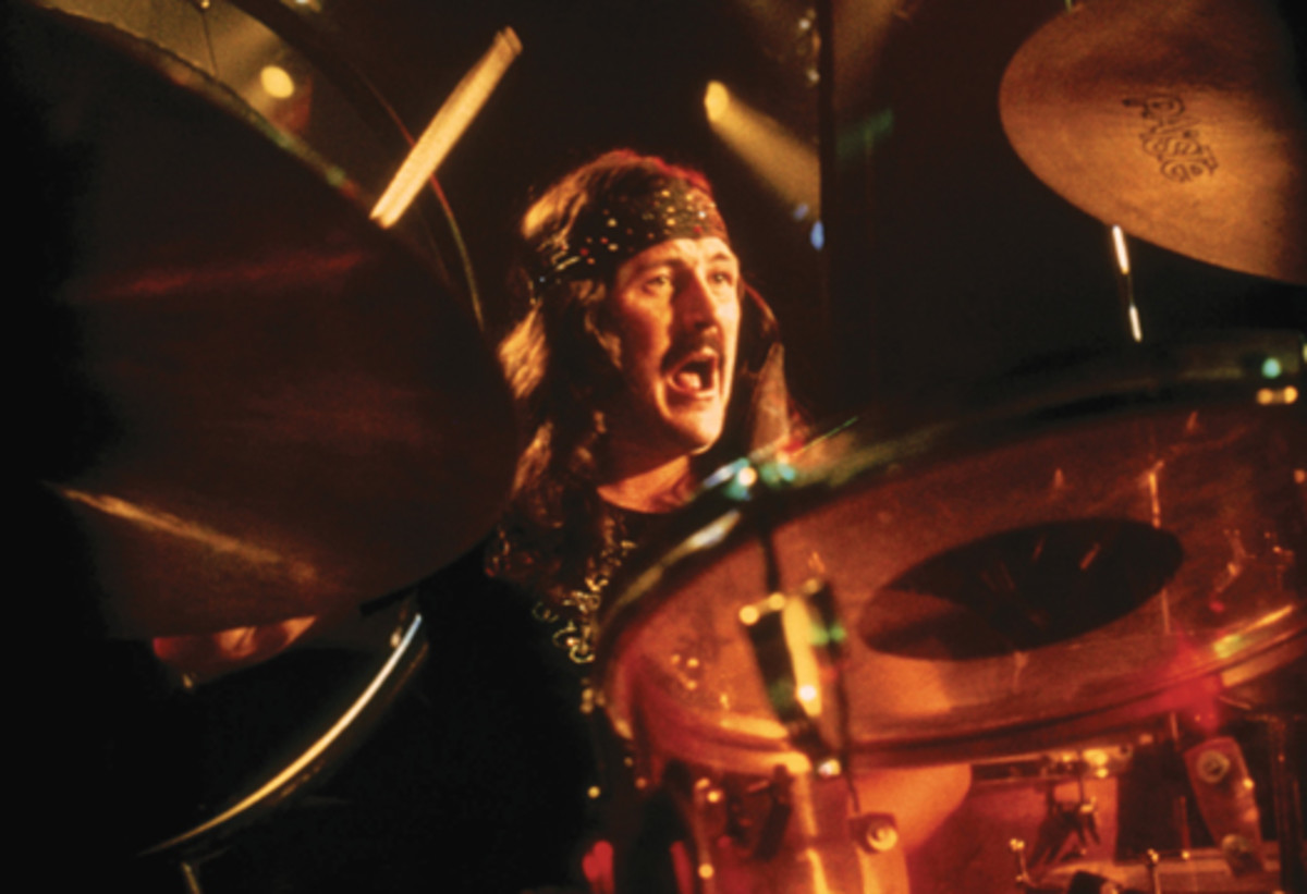 """LIKE FATHER, LIKE SON: John Bonham (above) keeps the beat in this scene from Led Zeppelin's motion picture """"The Song Remains The Same."""" His son, Jason, has made a name for himself as a drummer, too. Jason will use his father's drumming on """"When The Levee Breaks"""" as a backing track and profile his own fills and flourishes in concerts for the upcoming """"Jason Bonham's Led-Zeppelin Experience."""" Photo courtesy Rhino/Warner Bros. Entertainment Inc."""