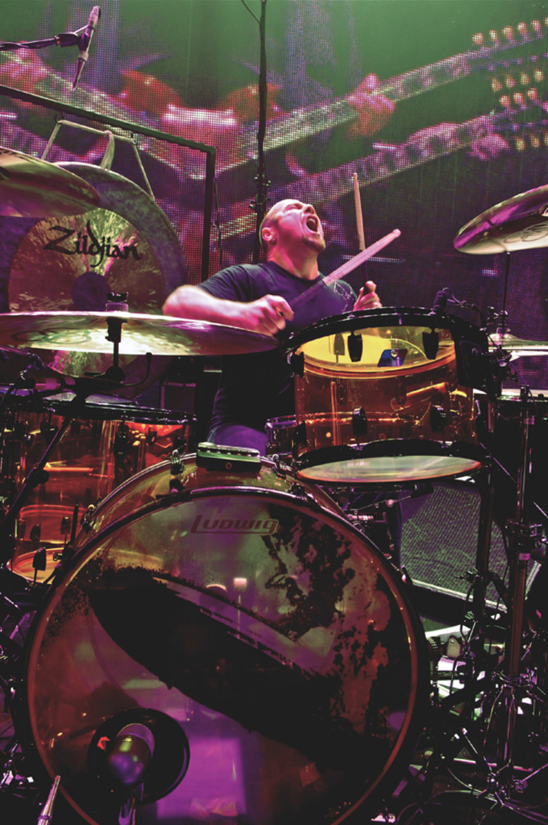 """DRUMMER JASON BONHAM, shown here drumming during the Led Zeppelin O2 Arena concert in Britain in 2007, will share the legacy of Led Zeppelin with a new generation. The 30-date """"Jason Bonham's Led-Zeppelin Experience"""" concert series will commemorate the 30th anniversary of the death of his father, Led Zeppelin drummer John Bonham. Photo courtesy Jason Bonham/Ross Halfin"""