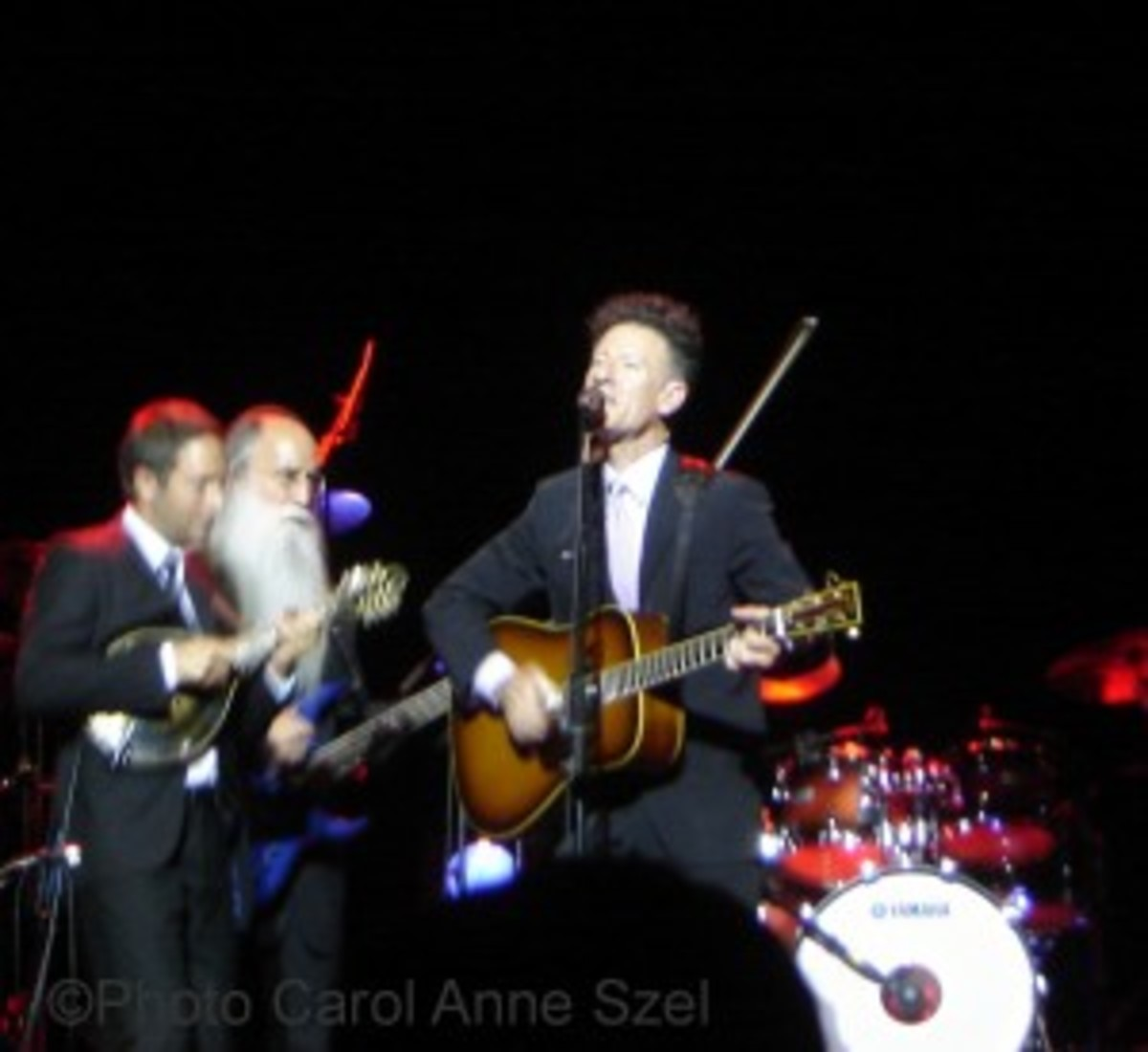Lyle Lovett front with 2 players - best watermarked