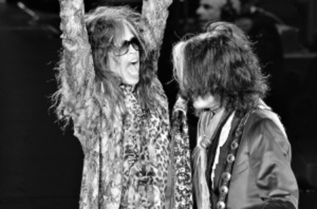 Steven Tyler (left) and Joe Perry share a microphone during the early portion of Aerosmith's Nov. 23 show at Revel in Atlantic City, N.J. (Photo by Chris M. Junior)
