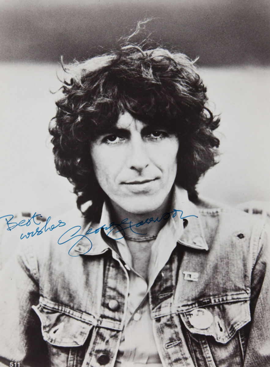 George Harrison autographed photo signed in blue ink