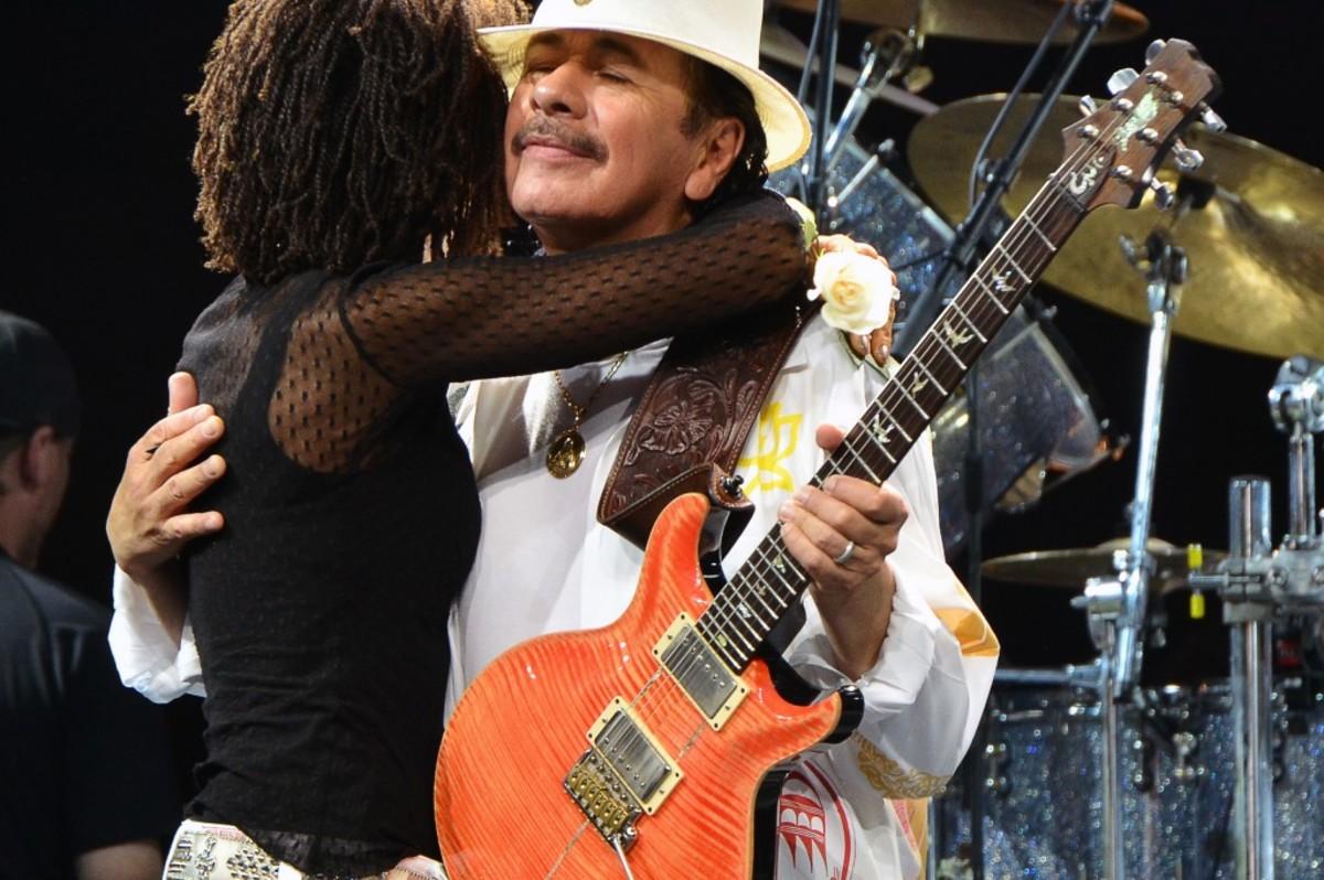 Carlos Santana embraces wife Cindy Blackman Santana onstage at The Borgata following his birthday cake presentation. (Photo by Chris M. Junior)