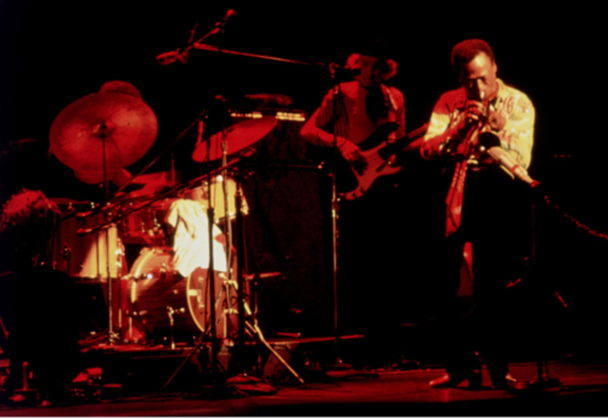 Miles Davis live. Left to right, drummer Jack DeJohnette, bassist Dave Holland, and Miles. Photo by Sandy Speiser