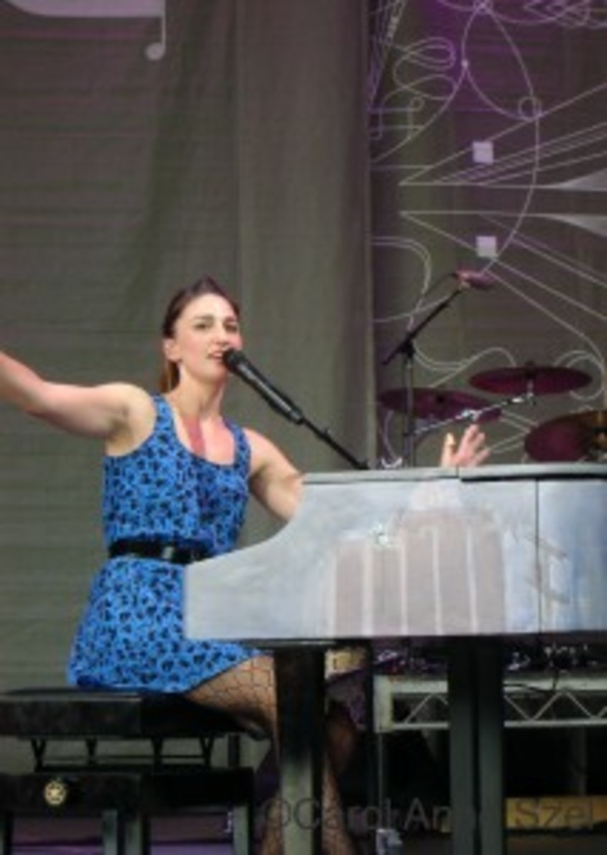 Sara B on stage at piano