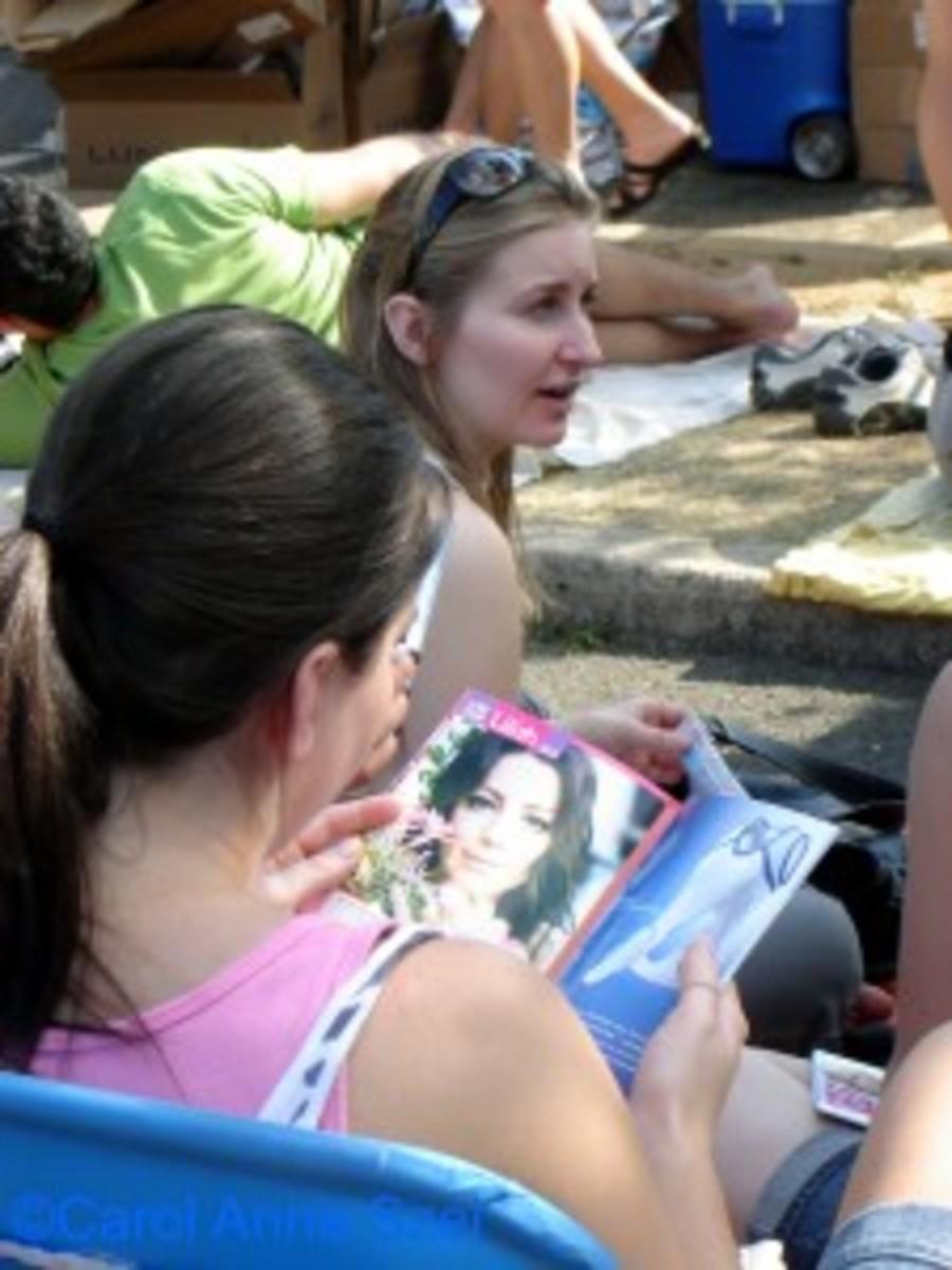 Lilith girl reading playbill - wm