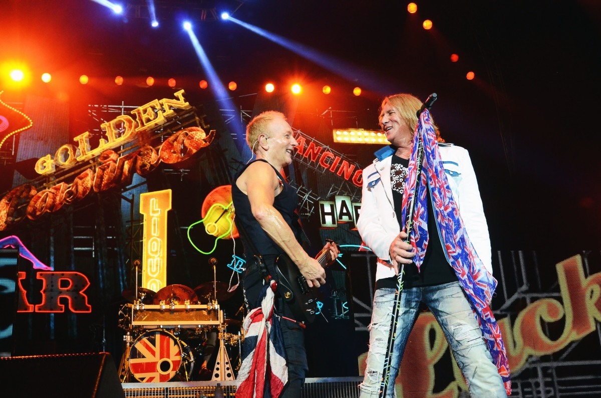 Def Leppard's Phil Collen (left) and Joe Elliott exchange smiles during the band's set on Aug. 3. (Photo by Chris M. Junior)