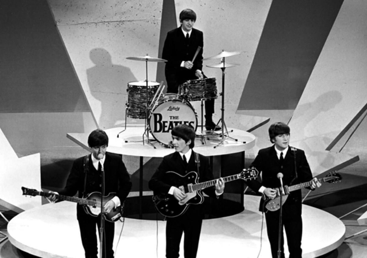 "The Beatles perform on ""The Ed Sullivan Show,"" New York, on Feb. 9, 1964. Credit: Apple Corps Ltd."