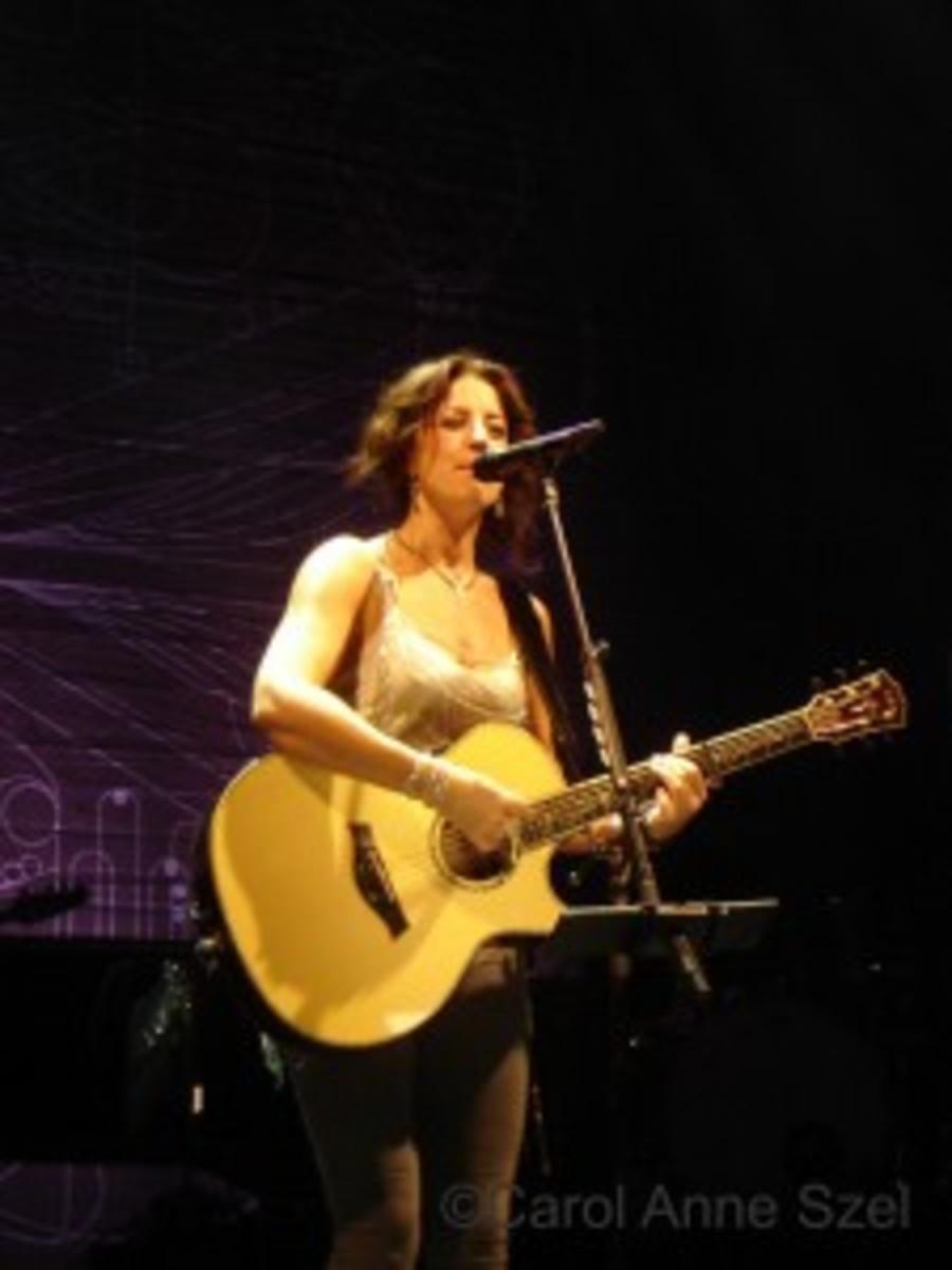 sarah mc on stage with guitrrr.JPG -wm