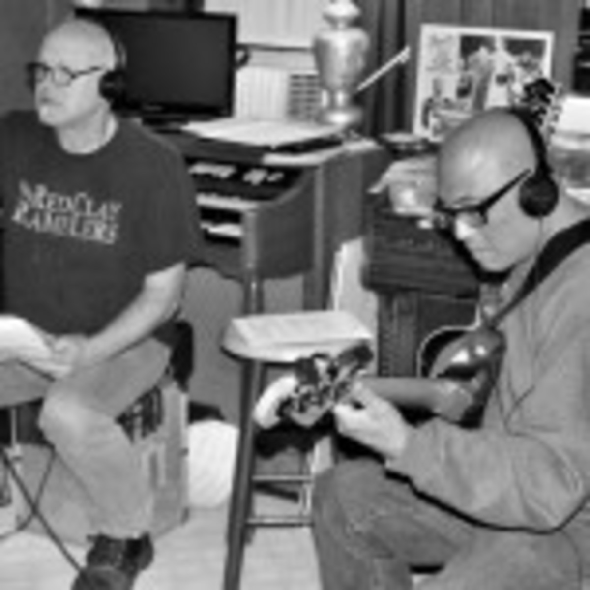 Severo Jornacion overdubs a bass line during a Dec. 13 recording session for the upcoming Smithereens album, which is being produced by Don Dixon (left). (Photo by Chris M. Junior)