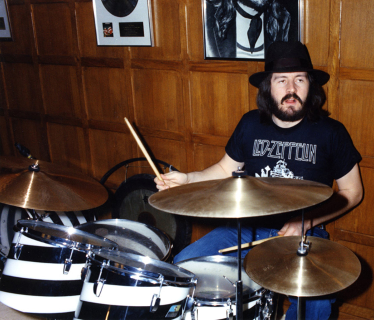John Bonham drumming and wearing hat