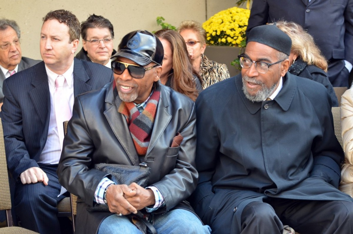 Leon Huff (front left) and Kenneth Gamble take in the Walk of Fame ceremony outside the DoubleTree hotel on South Broad Street. (Photo by Chris M. Junior)