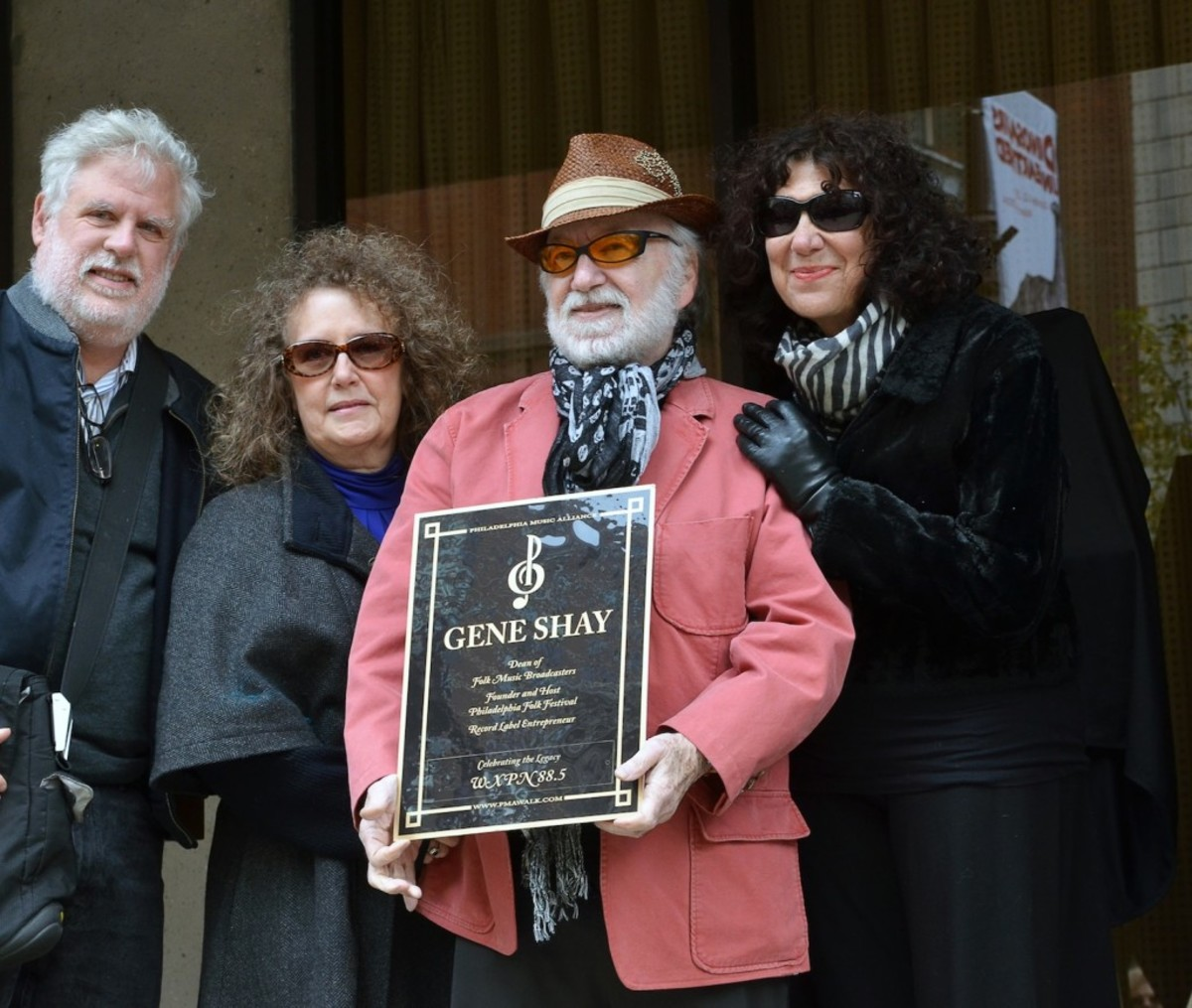 WXPN-FM air personality Gene Shay, who hosts a weekly folk show on the station, holds his replica plaque. With him are colleagues David Dye, Helen Leicht and Michaela Majoun. As a promoter, Shay was the first to bring Bob Dylan to Philadelphia. Shay is also the founder of the Philadelphia Folk Festival. (Photo by Chris M. Junior)
