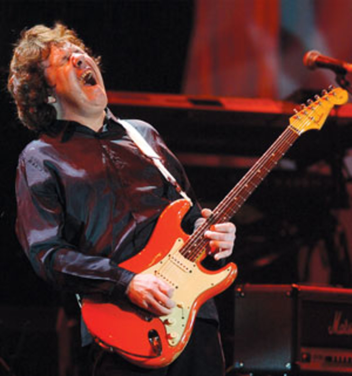 MOORE performs at the Wembley Arena in London, England, 2004 (AP Photo/Richard Lewis).